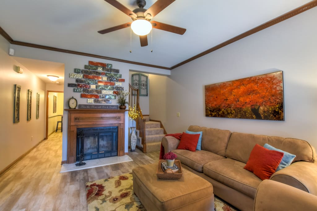 Living room area with wood burning fireplace - perfect on those chilly nights.