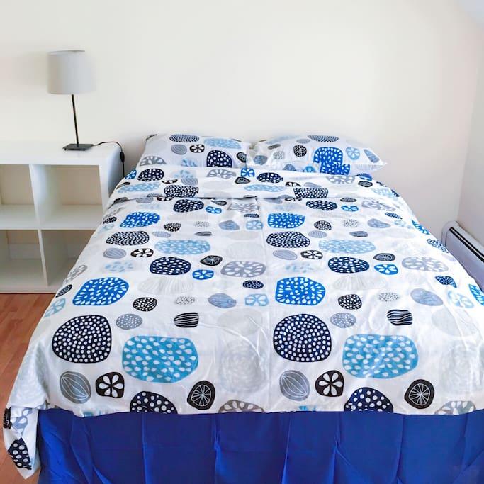 Double bed and hardwood floor