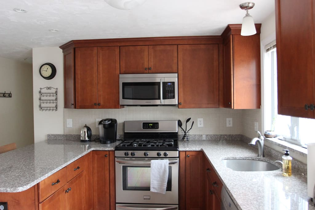 Renovated kitchen with stainless steel appliances. Fully-stocked with gas stove, dishwasher, fridge, microwave, electric kettle, Keurig coffee machine, rice cooker, toaster oven, cooking gear and basic spices.