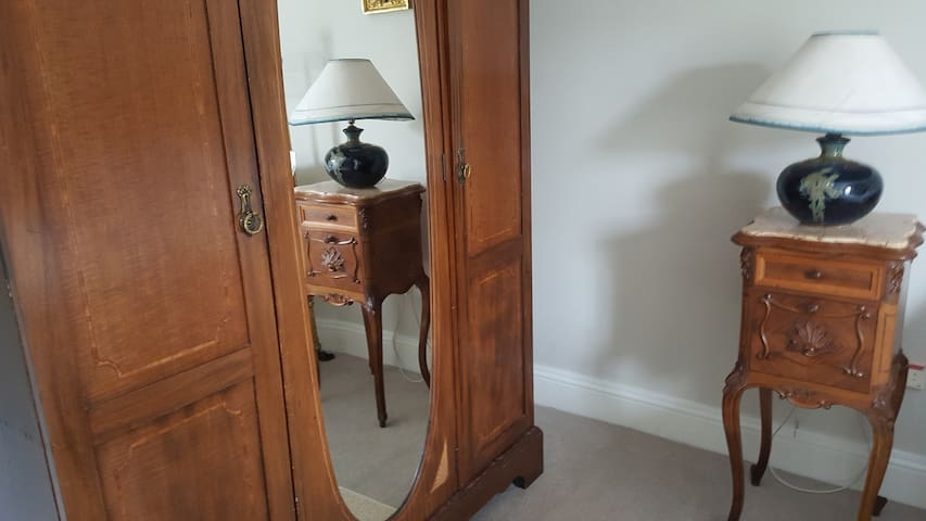Victorian marble top night table reflected in wardrobe miror