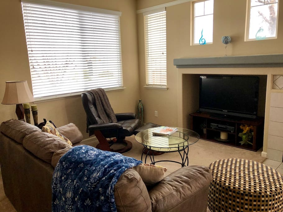 Watch movies with family or friends in the comfy living room