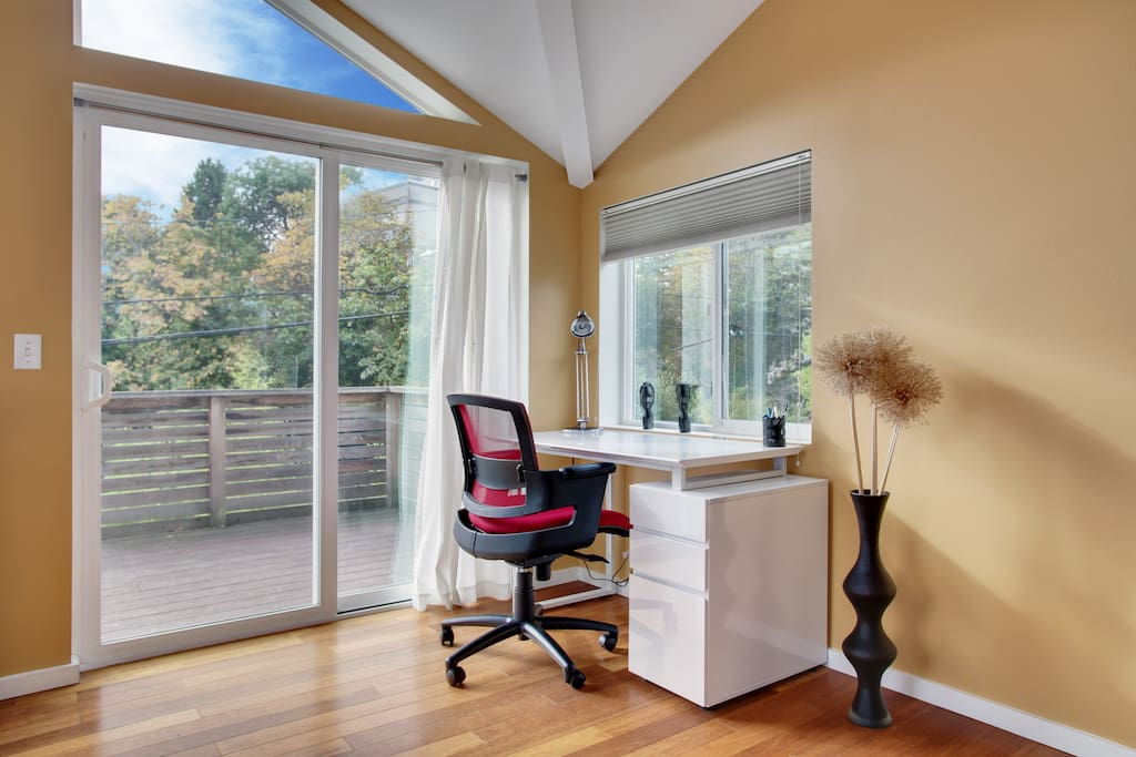 Pro work space with comfy chair & plenty of light.