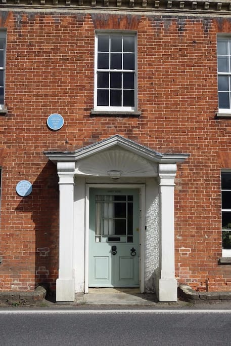 Front door with plaques commemorating  famouse residents; Author Margery Allingham and Dr. John Salter