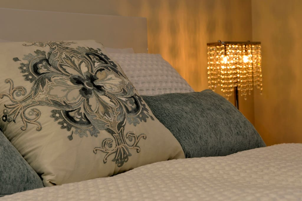 Luxurious bedding and lighting.