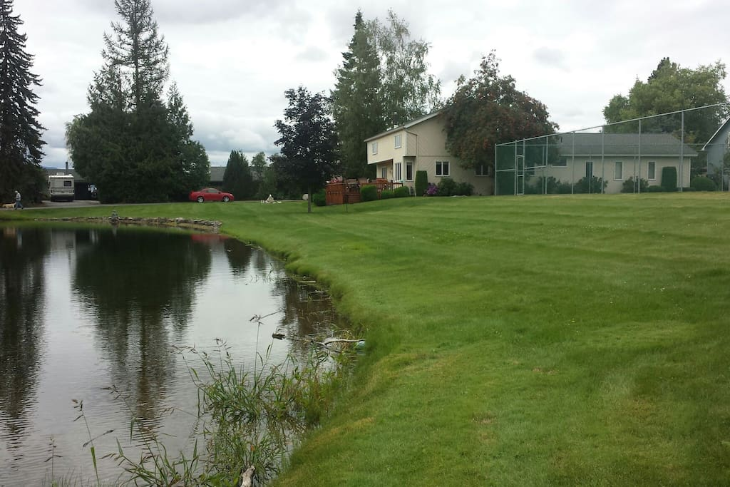 Back of home, tennis courts and pond.