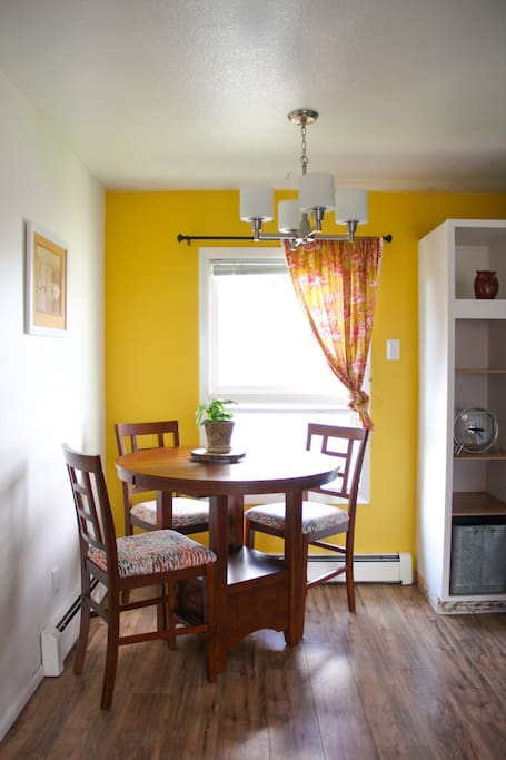 A peek into the colorful kitchen nook. A lovely spot to wake up with coffee in the morning.
