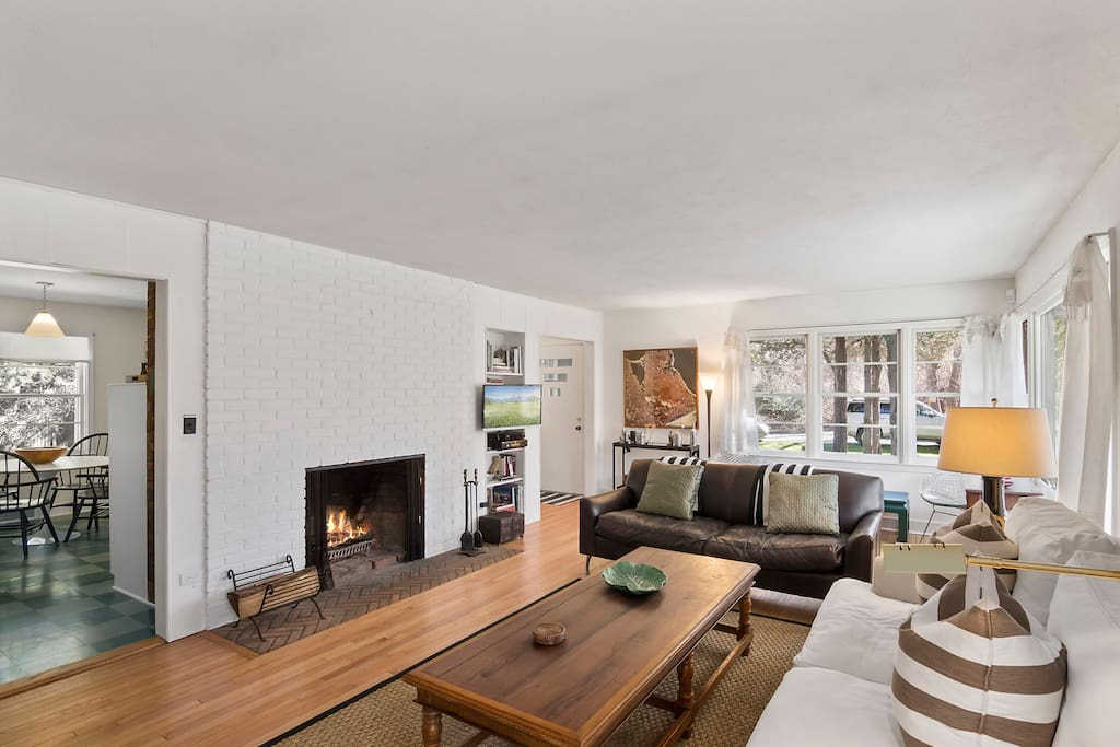 High-speed wireless, TV, phone... wood burning fireplace... relax in open, inviting living room.