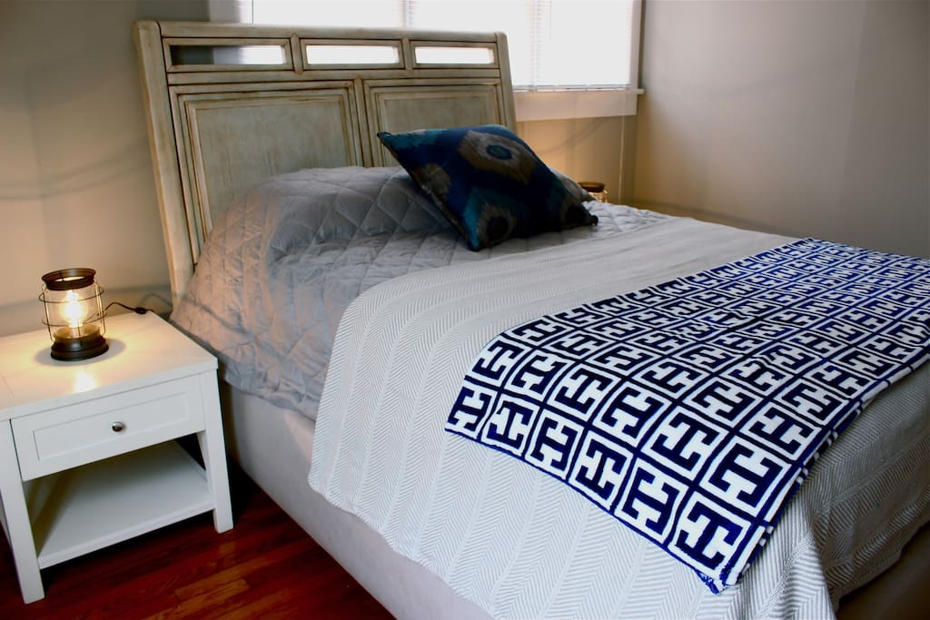 Come home to a comfy queen bed with a pillow top mattress!