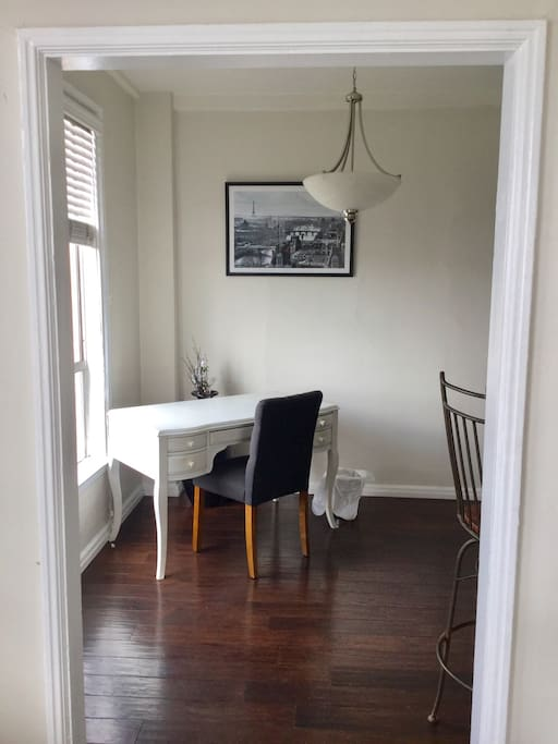 Writing nook, kitchen, and dining area are separate from the bedroom.