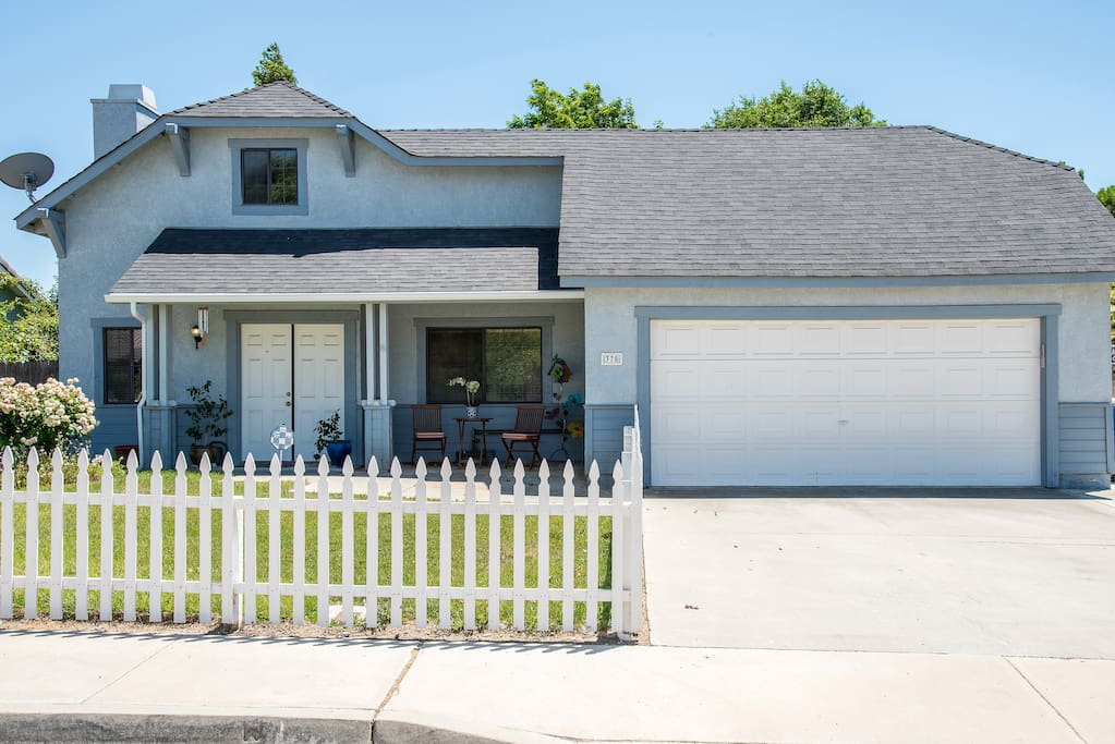 What better spot for a family vacation than a house with a white picket fence?