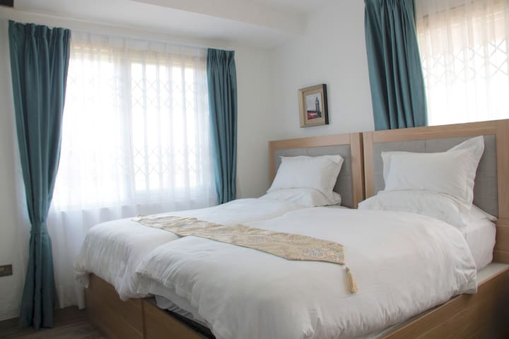 Room with 2 comfortable single beds and a private bathroom