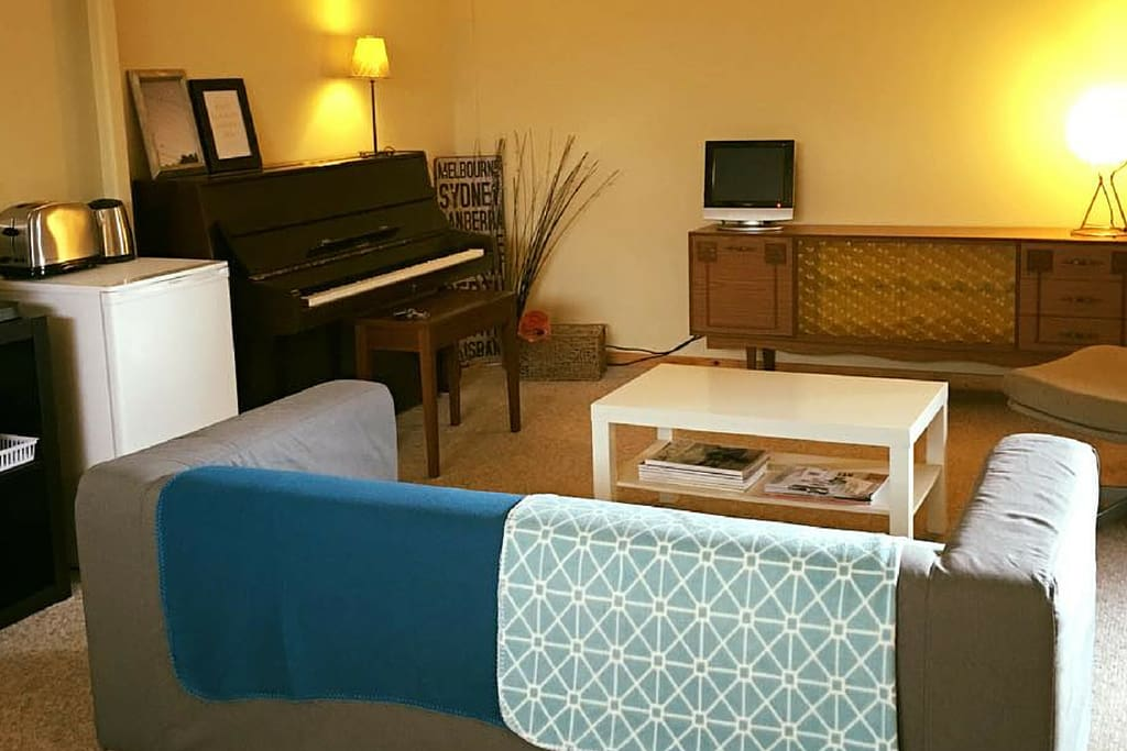 Your own living area in The Top Shed! There's even a piano for our music loving guests!