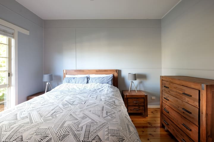 The master bedroom has a queen bed and ample storage in the wardrobes and tall boy.