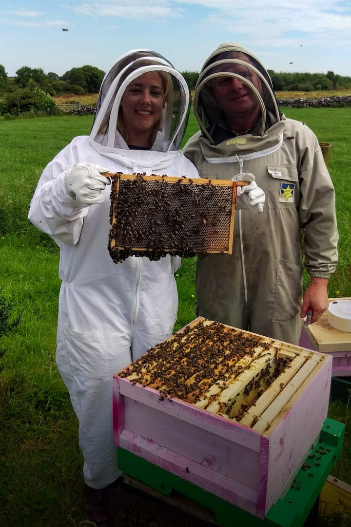 Happy guest and the honey man