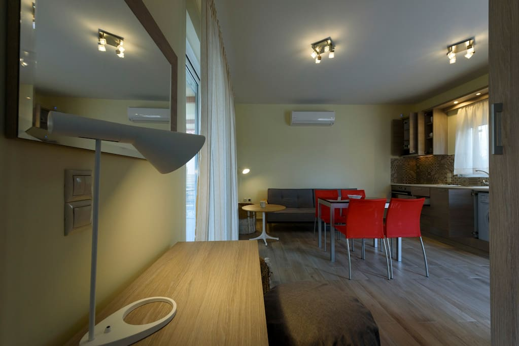 Interior view - living room, dining table and fully equipped kitchen