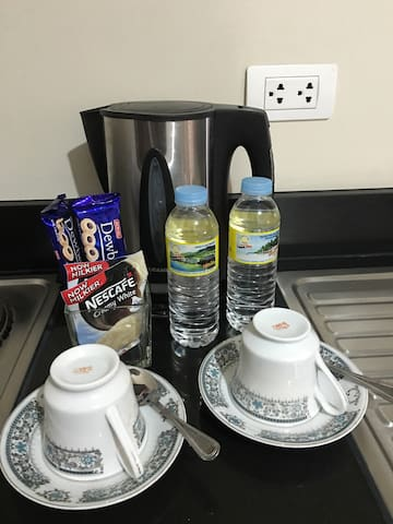 Complimentary bottled water, coffee and biscuits