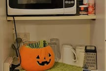 Bar fridge, microwave and kitchen equipment