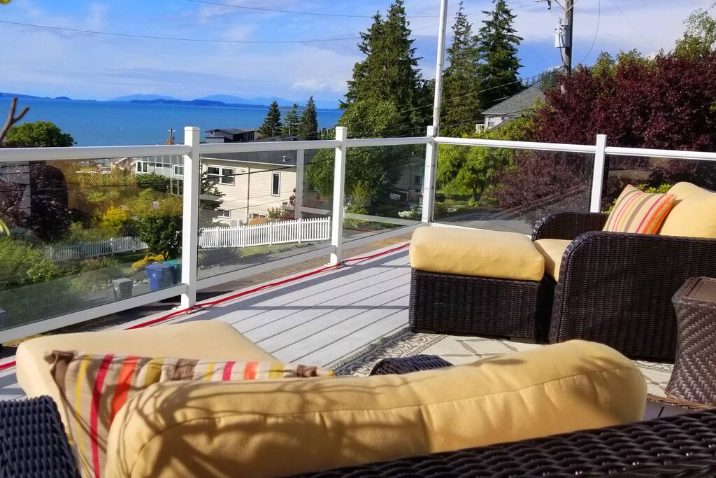 Front Deck with beautiful sunrises and sunsets.  180 degree views of the islands.