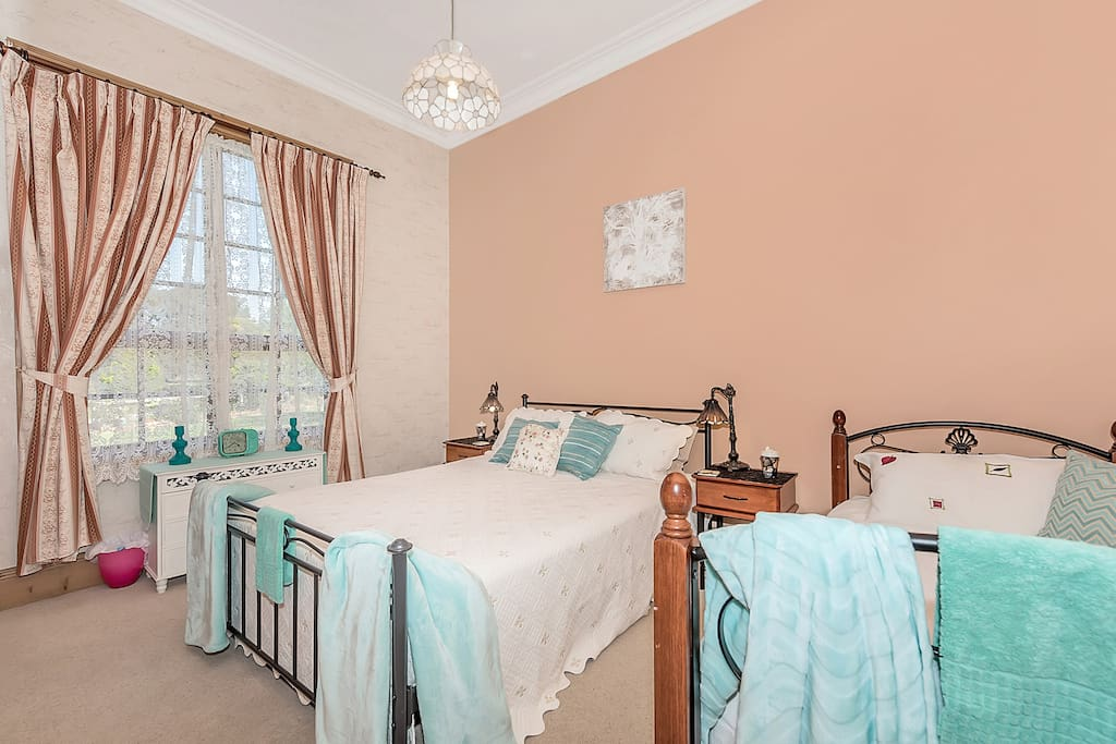 Chestnut Room. Warm and inviting with queen and single beds.