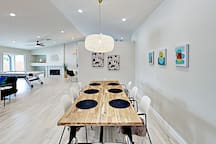 Contemporary artwork surrounds the 8-person dining area (A high-chair is available for a small kid)