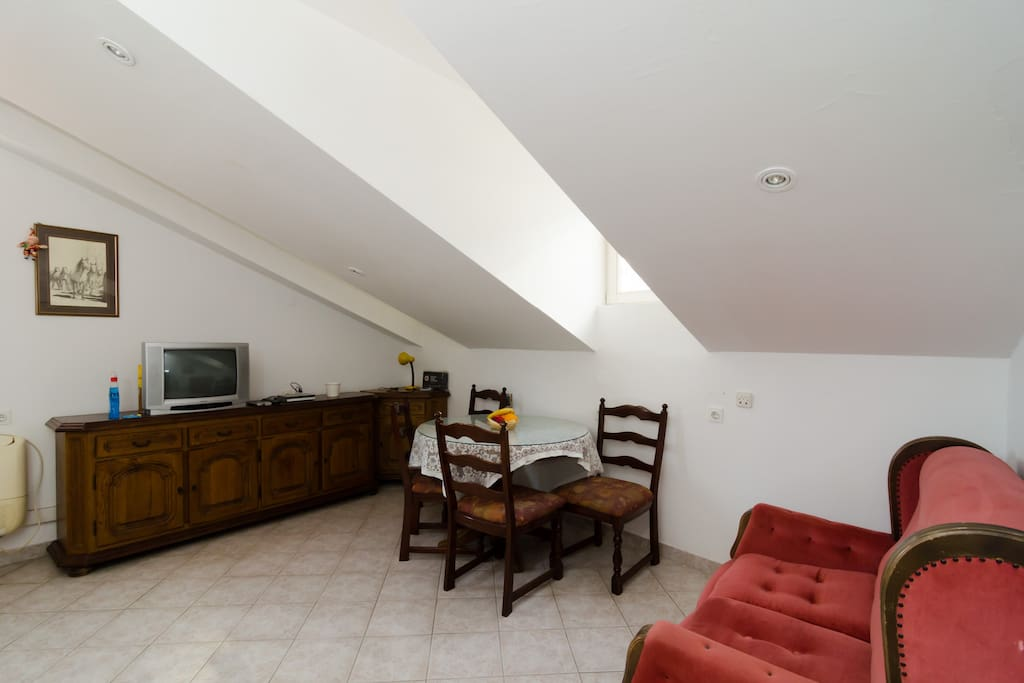 Living room, seating area, dining area