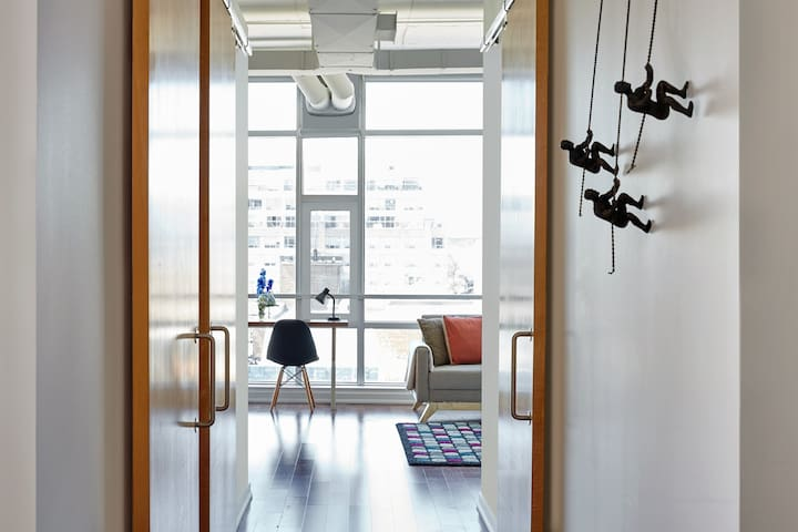 Trendy and inspiring - high ceilings with hardwood floors throughout.
