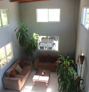 Modern Riverside Cabin - Talo
