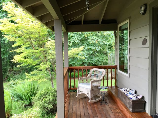 Relax in Rocking Chairs or Hammock Swings on the Quiet Front Porch