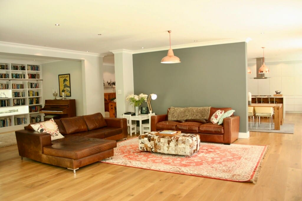 Open plan lounge linking to the dining room, kitchen, library, play area and patio