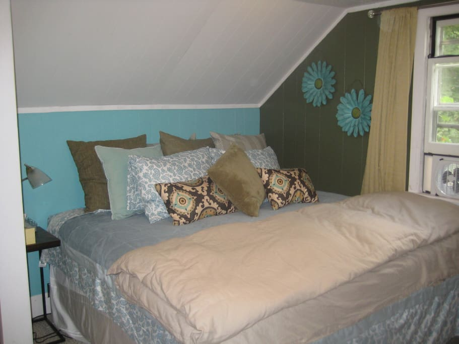 King bed in sunny bedroom.  Extremely comfortable and roomy.