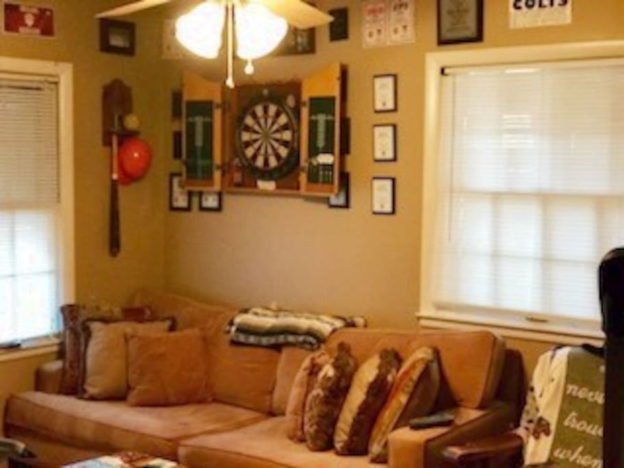 Living room? Darts anyone? Fan feels great! Grab a power nap on the couch!