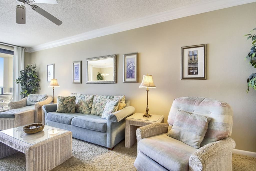 Living area with plenty of comfortable seating and a Sleeper Sofa