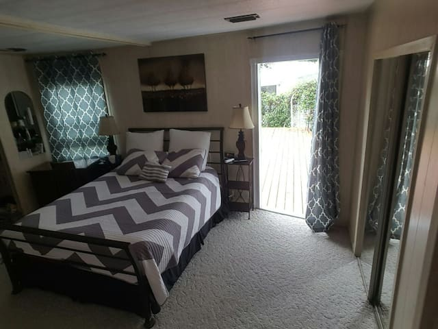 Room/Suite style with door to access back deck.