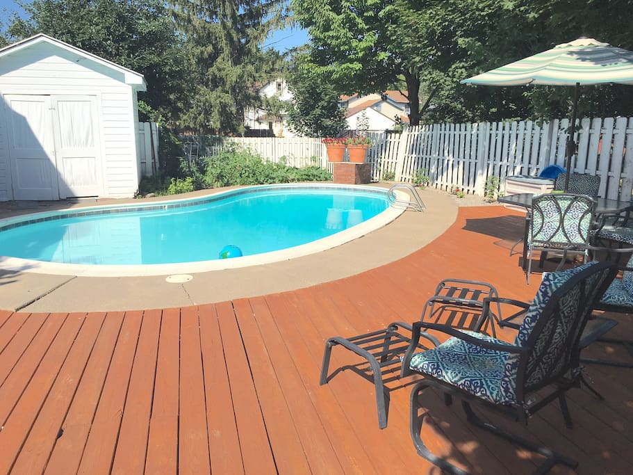 The home features a heated in ground pool with extensive decking and seating
