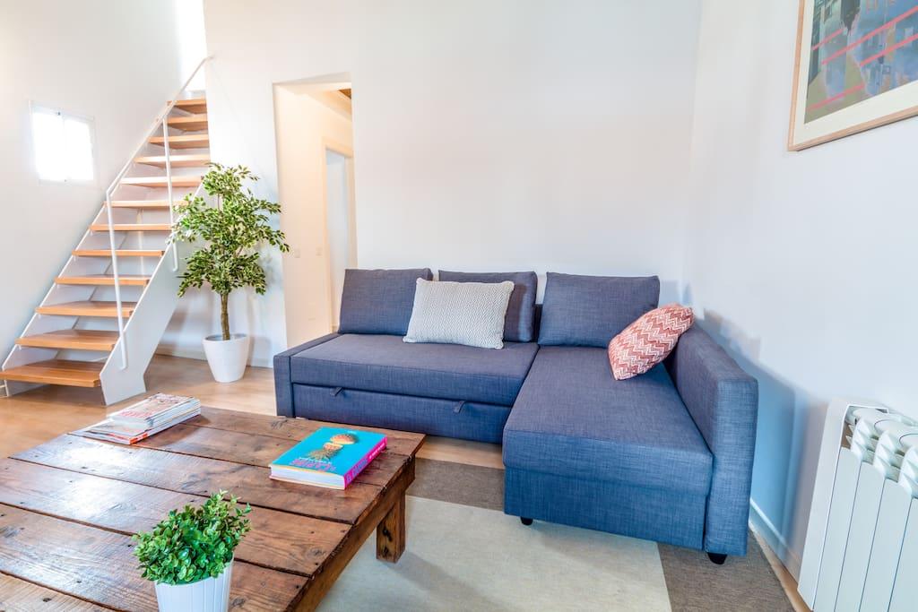 Salón - comedor con sofá cama doble