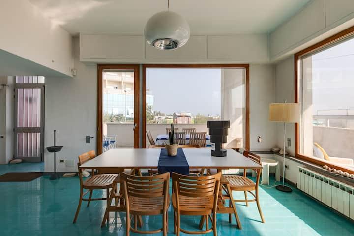 Appartamento in villa con piscina in riva al mare