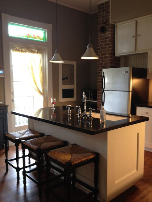 Kitchen is fully furnished with an island and bar stools!  Wine fridge and cooler size ice maker.