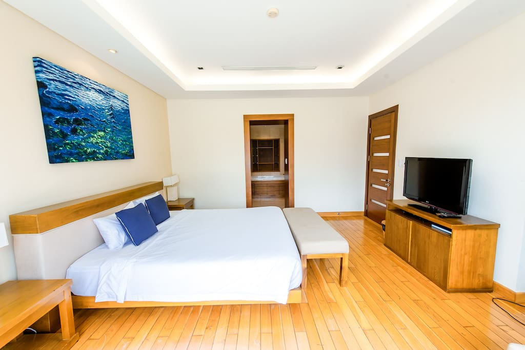 Bedroom # 1 on the second floor. Spacious oasis, with balcony to view the garden space in the back.