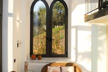 Love seat and hillside window