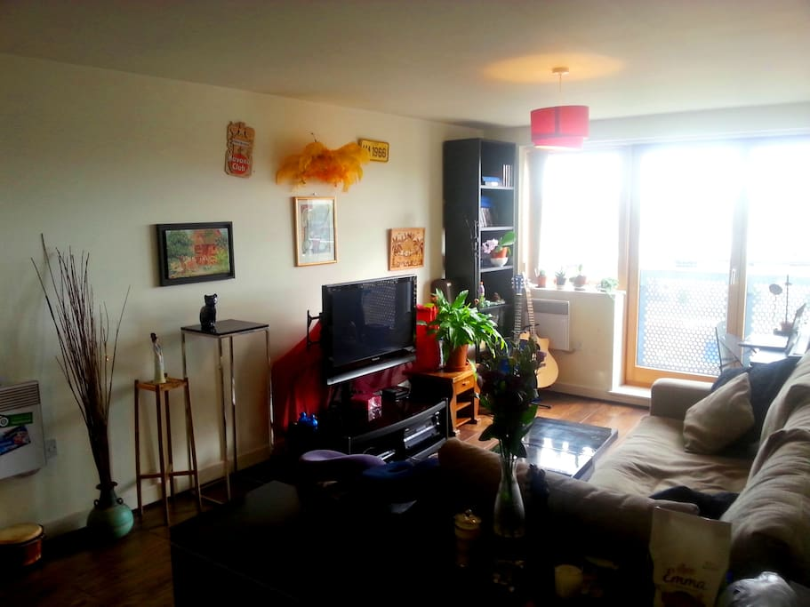 The living area, very comfortable sofa, TV with freeview, with a desk space by the window