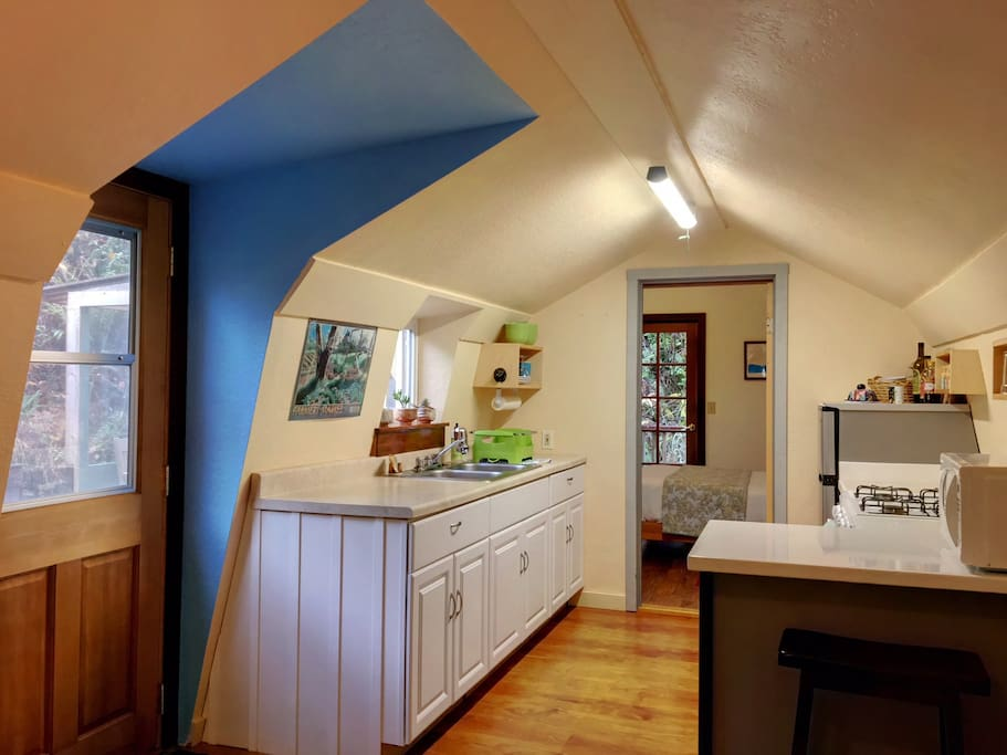 Enter into the kitchen stocked with coffee, tea and other essentials.