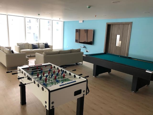 private room with gym , pool and activities area