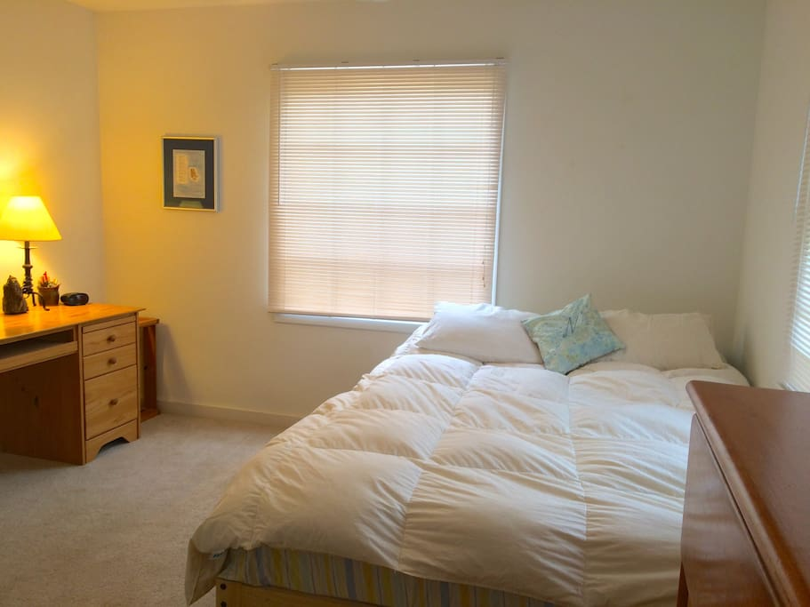 Your first floor bedroom set away from main rooms.