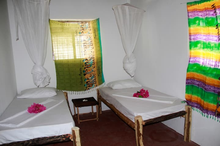 Double-Twin room in Sunny House Paje/