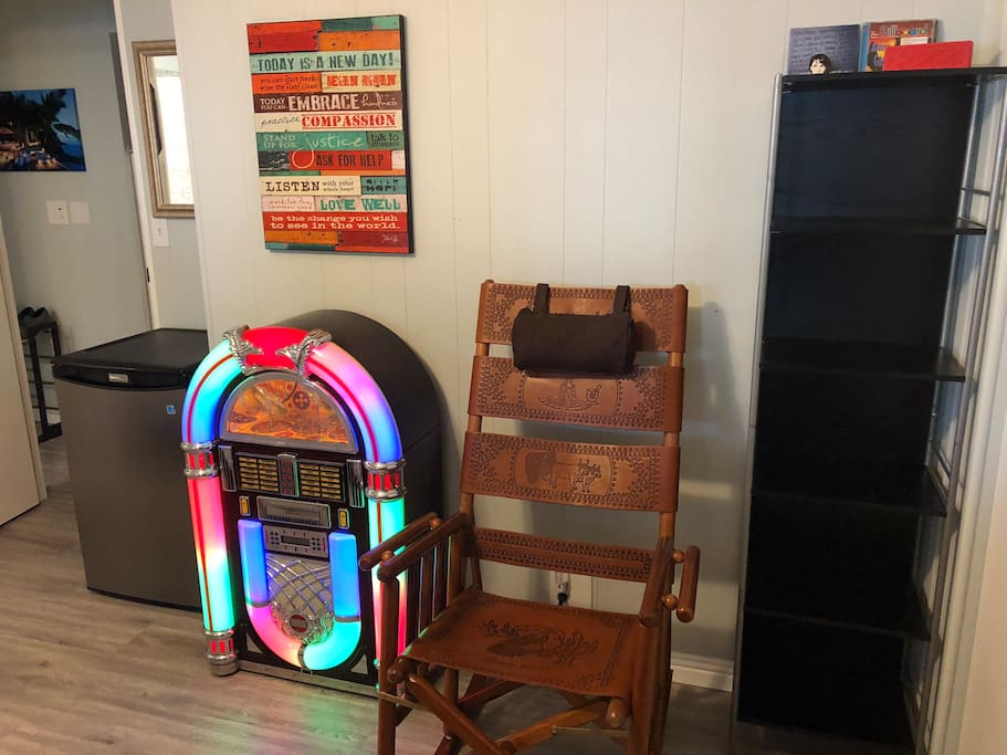 4.5 ft.³ fridge a real working jukebox with radio and CD a folding leather rocking chair and lots of storage space and a Bluetooth speaker