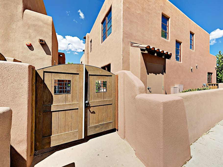 Nestled in an exclusive gated enclave, this 2BR/2BA condo with traditional Santa Fe Pueblo architecture is located just a few blocks from downtown.