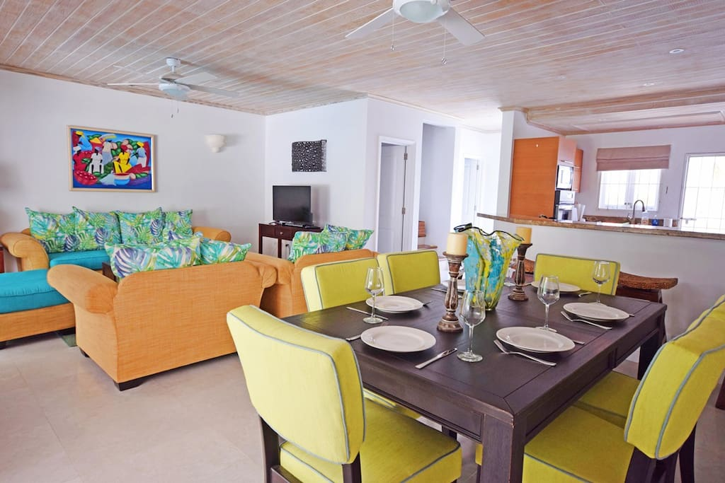 The open plan dining and living area flows into the fully outfitted kitchen
