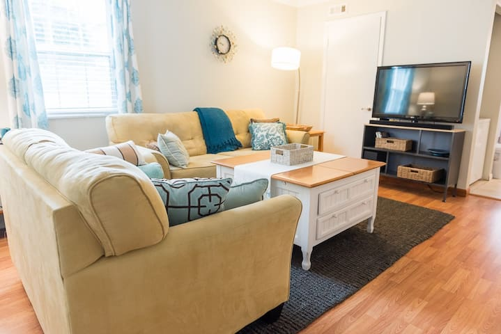 """Comfy great room with LG 42"""" flatscreen TV with Apple TV and  Bluetooth sound bar for playing your tunes!"""