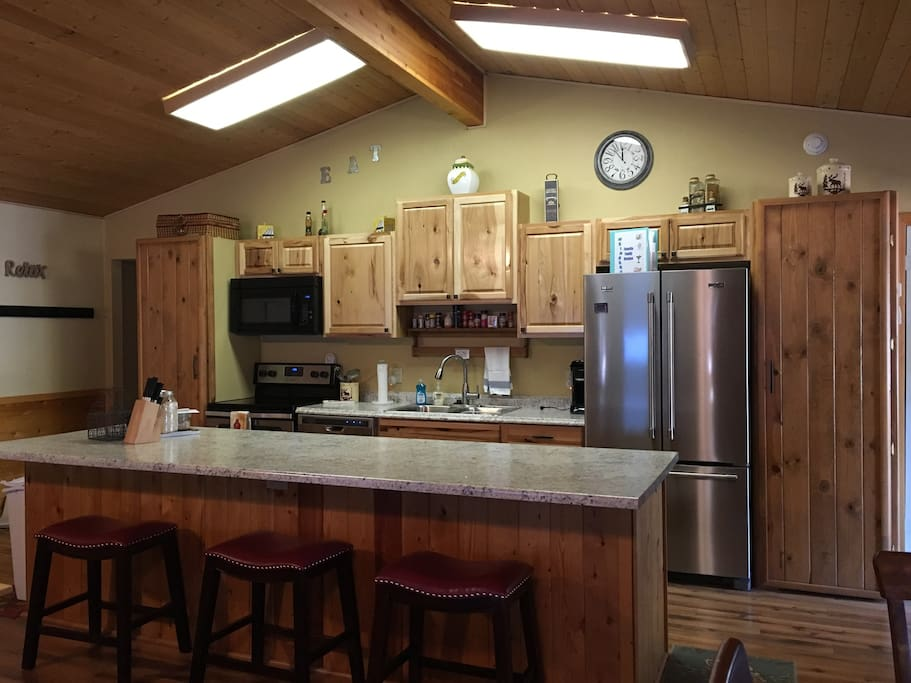 New updated kitchen with stainless appliances.  3 bar stools for extra seating.