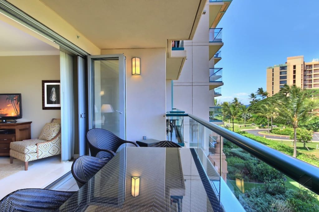 Look out at all the green tropical foliage from your private lanai.